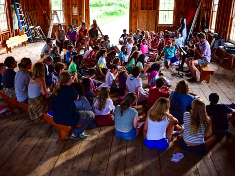 Campers gathering to listen to a performance