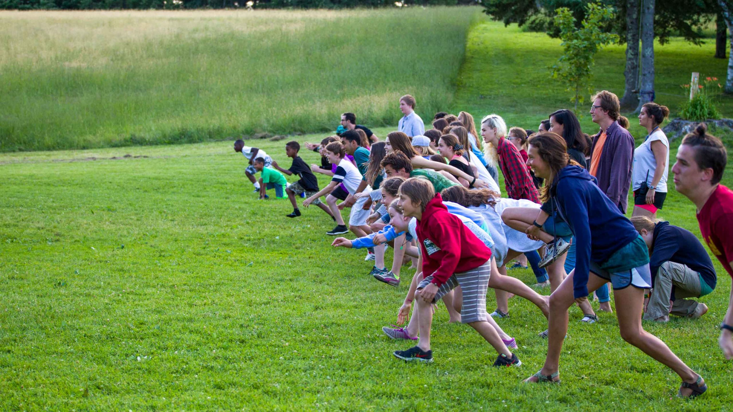 Campers getting ready to run across a field