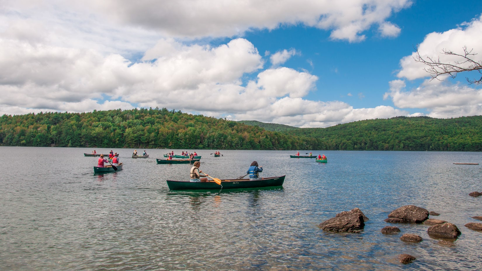 Campers exploring the lake in canoes.