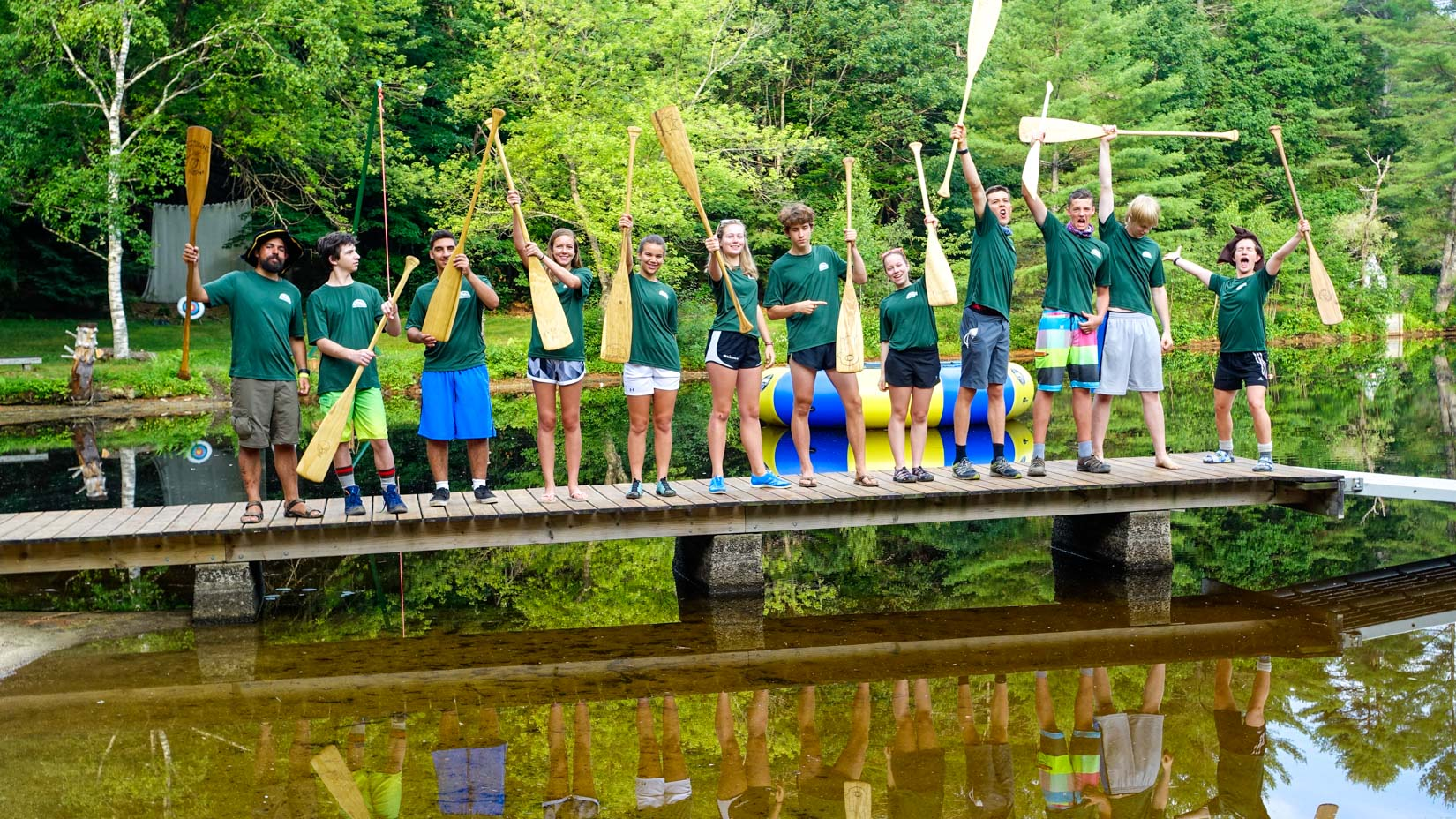Campers on a bridge with paddles
