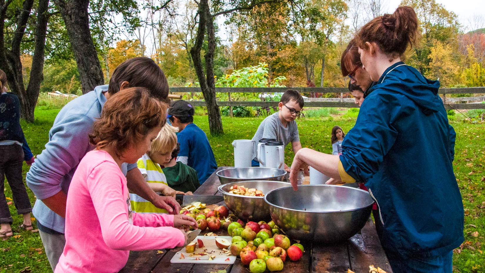 A group of campers peeling apples