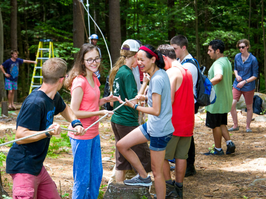 Campers getting ready for high ropes course adventures.