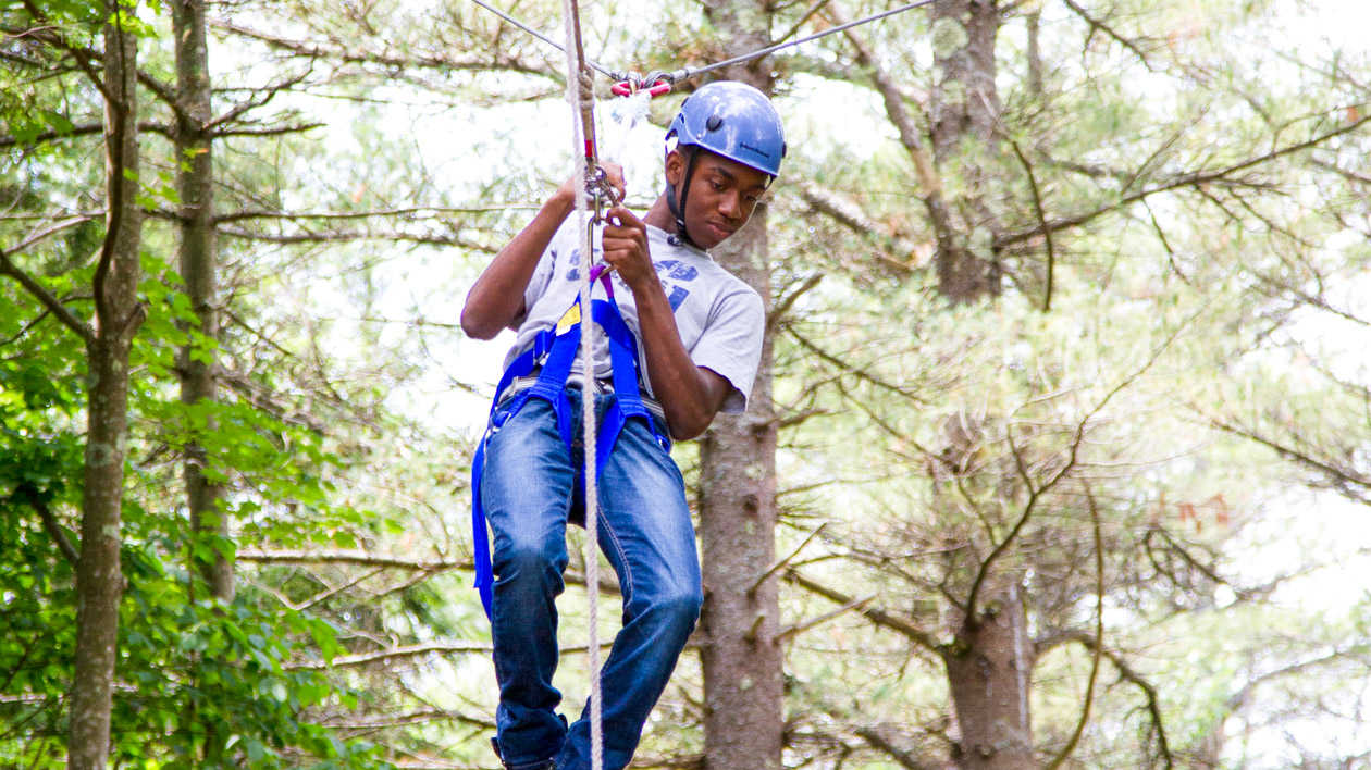 A camper on the high ropes course.