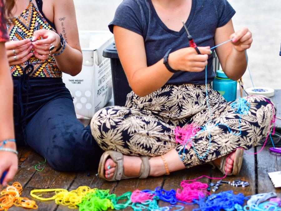 Campers working on friendship bracelets