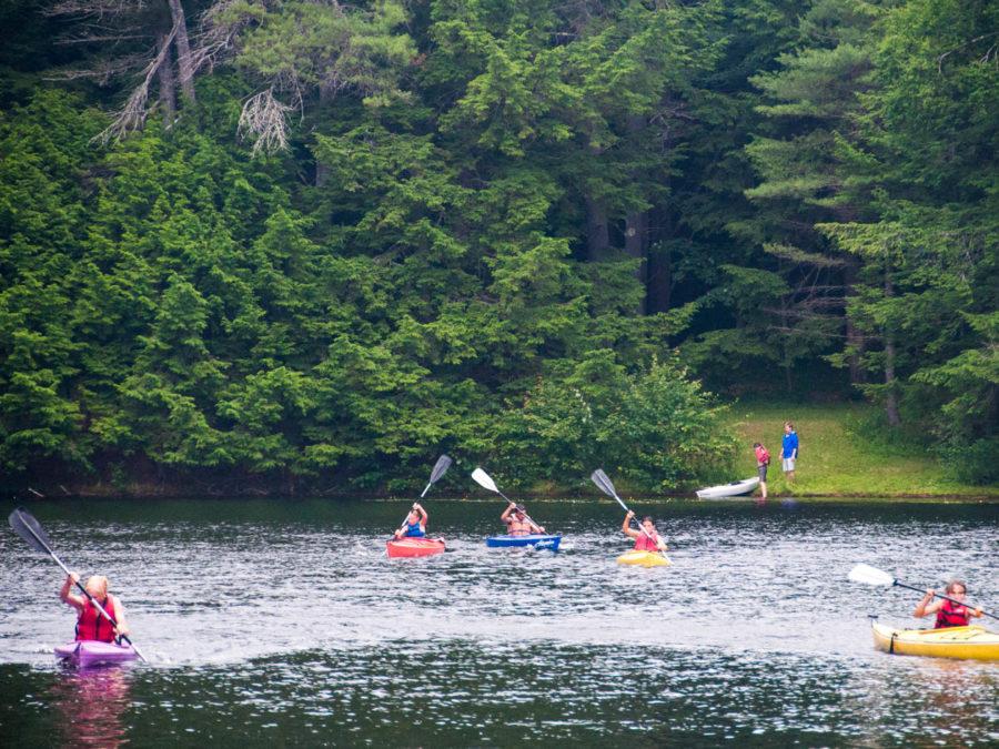 Campers kayaking in the lake.